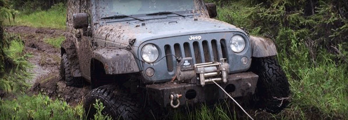 Jeep whinching its self out of mud
